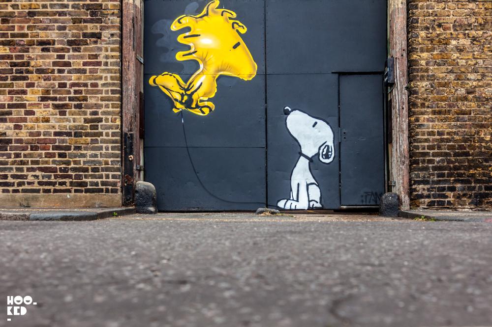 Snoopy Inspired Mural in Haggerston, London painted by street artist Fanakapan.