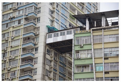 http://curbed.com/archives/2014/12/12/illegal-nanning-china-corridor-apartment.php