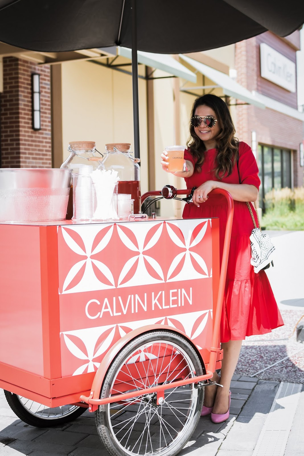 clarksburg premium outlets, shopping day, DC blogger, shoppinh haul summer, designer shopping, red kim and proper dress, red tiered dress, stripe heels, studded sunglasses, hair curls, myriad musings, summer of likes event