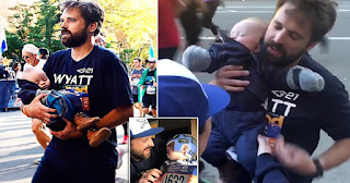 Πατέρας τερματίζει στο μαραθώνιο αγκαλιά με τον 7 μηνών γιο του που έχει σύνδρομο Down και συγκινεί