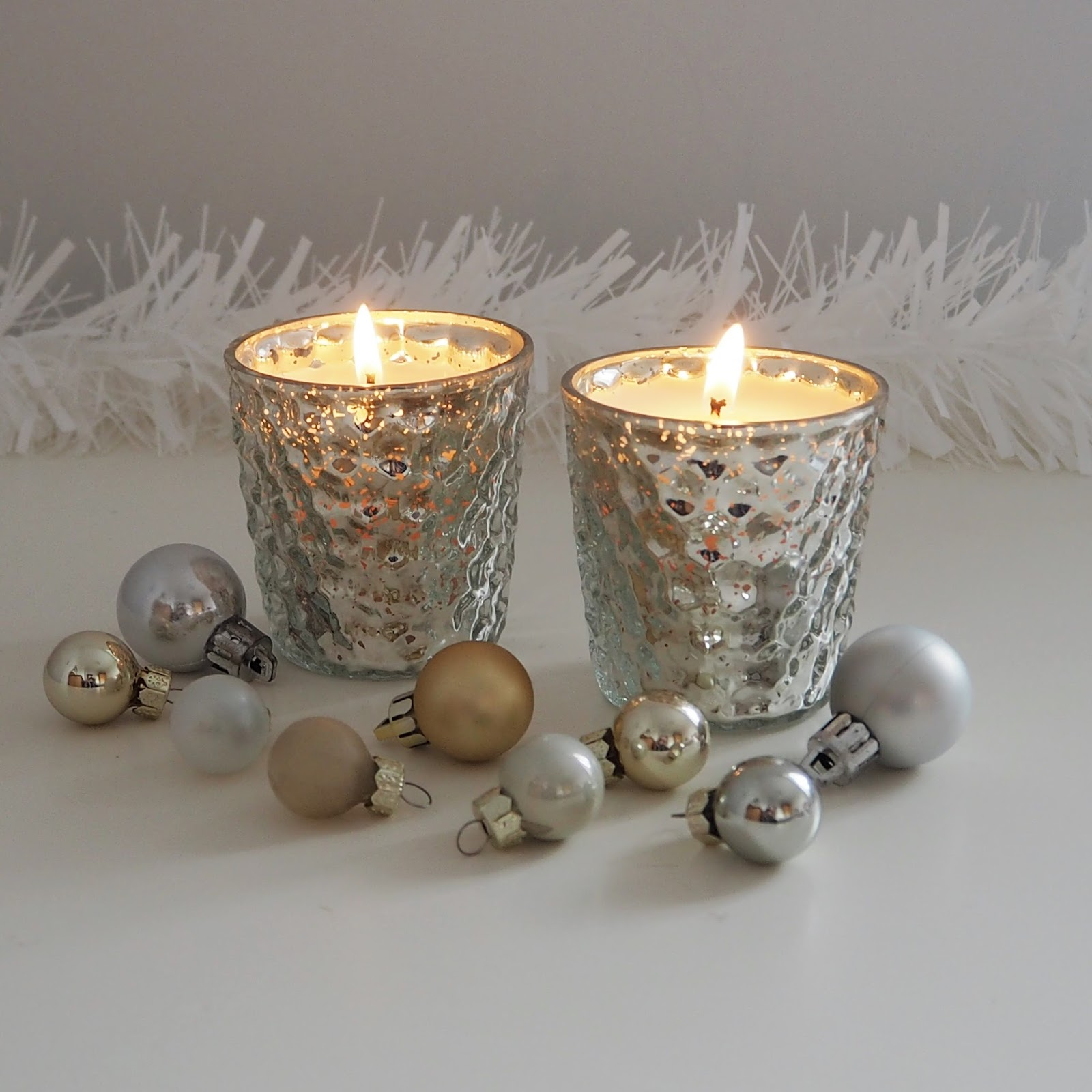 The White Company Winter candles in mercurised silver glass votives