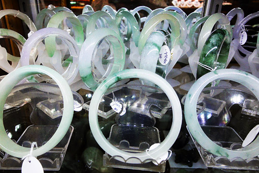 white jade bangles with bit of green