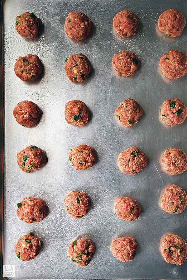 Mediterranean meatballs ready to bake in the oven to serve with my Greek Bowl recipe dinner
