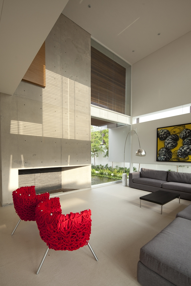Red chairs and concrete fireplace