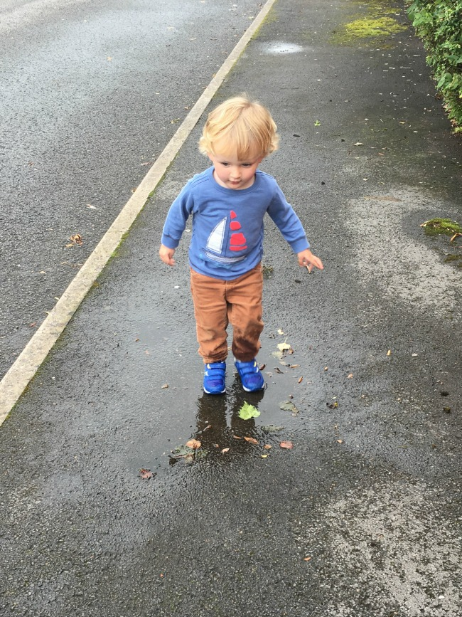 toddler-in-puddle