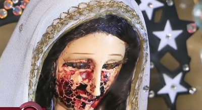 SHOCKING! Mystery As 'Blood' Poured From The Eyes Of A Statue Of The Virgin Mary