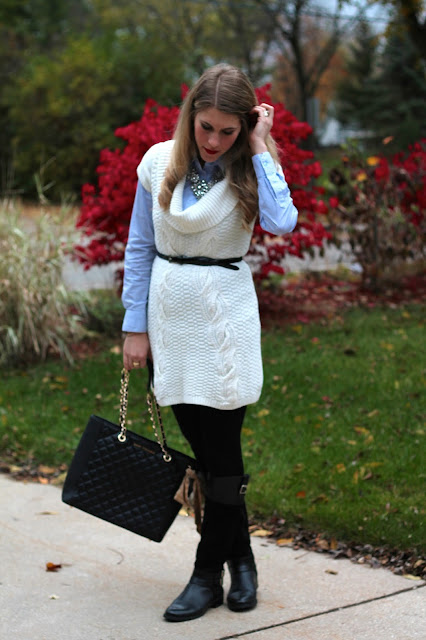 pinstripe top, belted white sweater dress, black riding boots