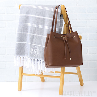 monogrammed towel with brown purse