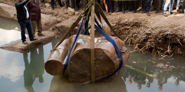 Torso of massive statue lifted from Cairo mud
