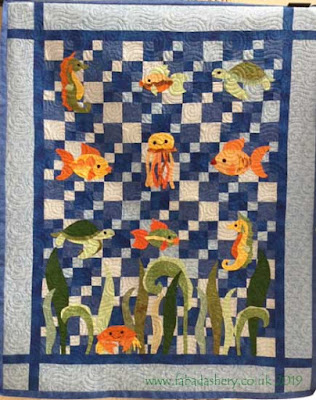 Underwater creatures quilt made by Valerie, quilted by Fabadashery Longarm Quilting