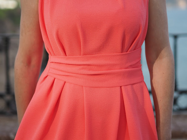 Coral asymmetric dress with gold stars jewellery