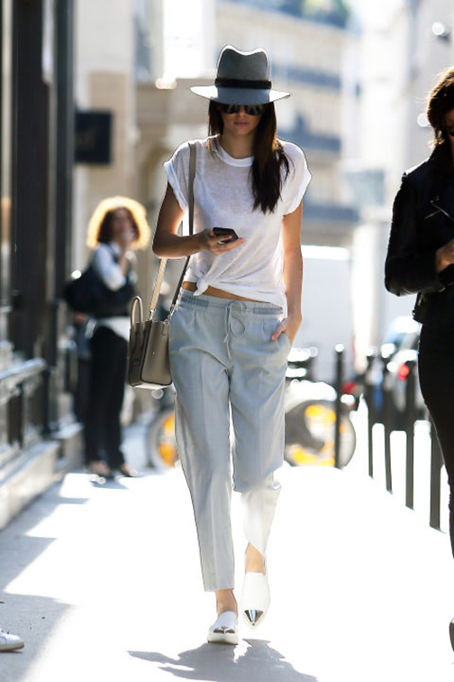trousers and loafers and white tee