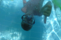 Image of child giving thumbs up under water: Children's Swimming Lessons