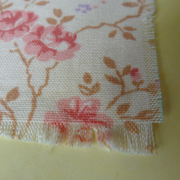 Fraying the edges of the cotton flower fabric