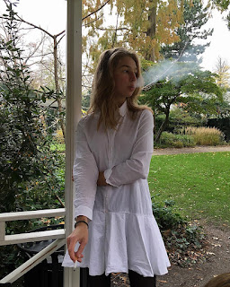 young teen smoking exhale