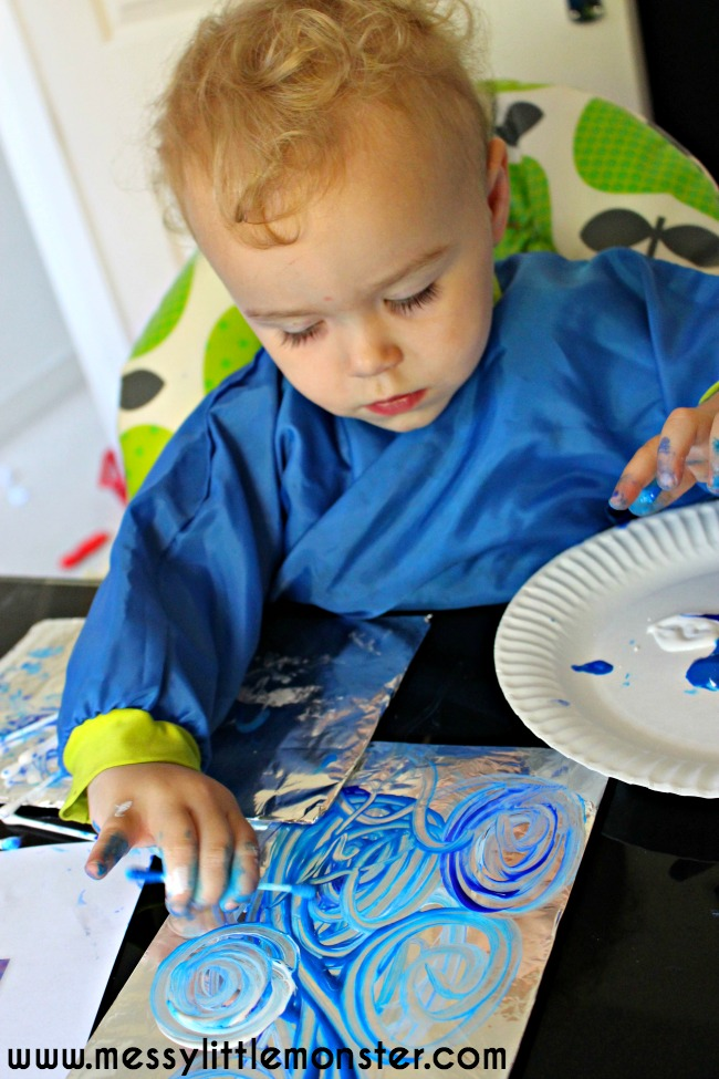 Painting on foil using q tips.  Fine motor skills and colour mixing for toddlers and preschoolers.