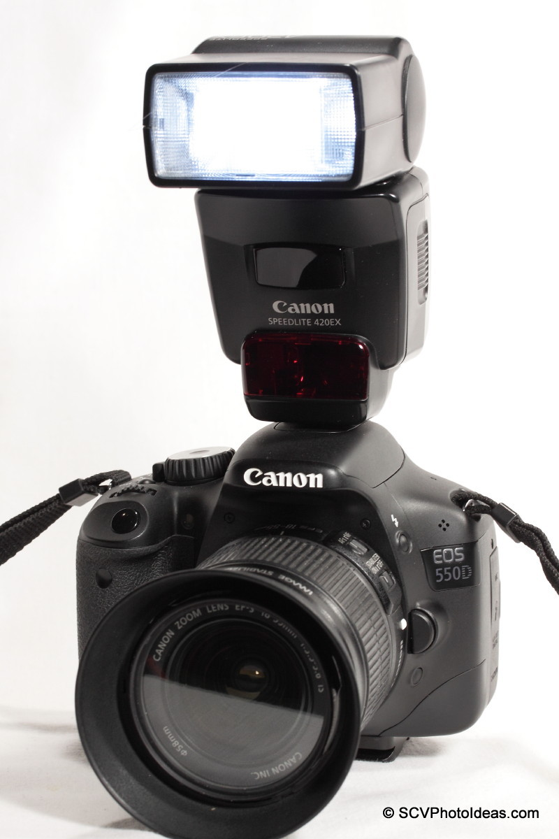 Canon Speedlite 420EX on EOS digital T2i / 550D front