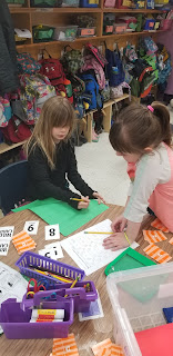 Students at math workplace