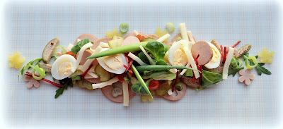 Käse-Wurstsalat mit Wachteleiern
