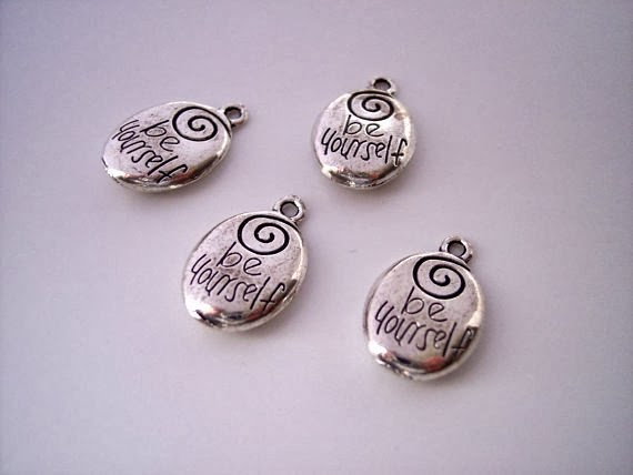 https://www.etsy.com/listing/179740419/pewter-charm-with-engraved-words-be?ref=favs_view_2