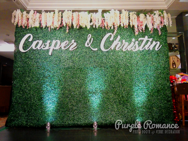 photo booth backdrop, stage backdrop, VIP table setting, photo table and reception table decoration, entrance arch, guest book, props for photo taking, malaysia, kuala lumpur, selangor, melaka, pahang, bentong, mentakab, raub, dangling flowers, spotlights, planner