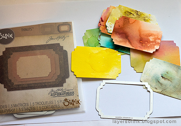 Layers of ink - Ticket Mini Book Tutorial by Anna-Karin Evaldsson with Tim Holtz Sizzix Stacked Label