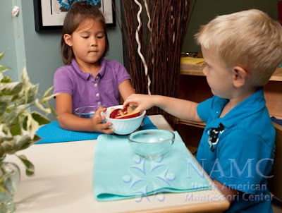 boy and girl work with NAMC montessori materials new montessori students new school year