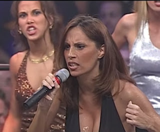 NWA: TNA - First Ever Event - Alexis Laree (Mickie James) looks on as Francine reminds us she's the Queen of Extreme
