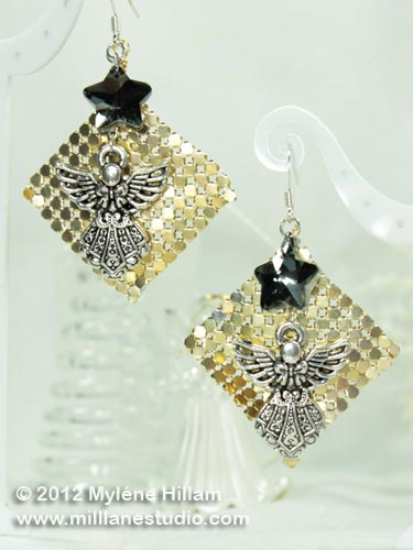 Angel earrings made with gold glow mesh and a smokey crystal star.
