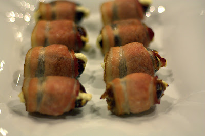 Two rows of bacon wrapped dates stuffed with goat cheese
