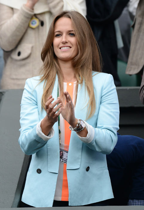 Kim has teamed her beautifully tailored blue blazer perfectly with a sleek  beige blouse striped tangerine down the middle. The pastels blend nicely  and the ...