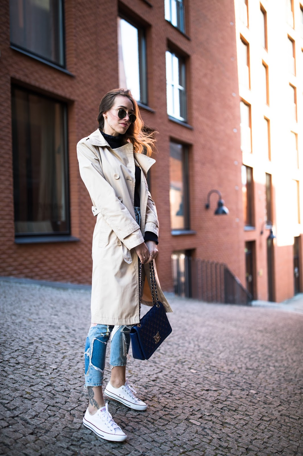 patch jeans trench coat street style