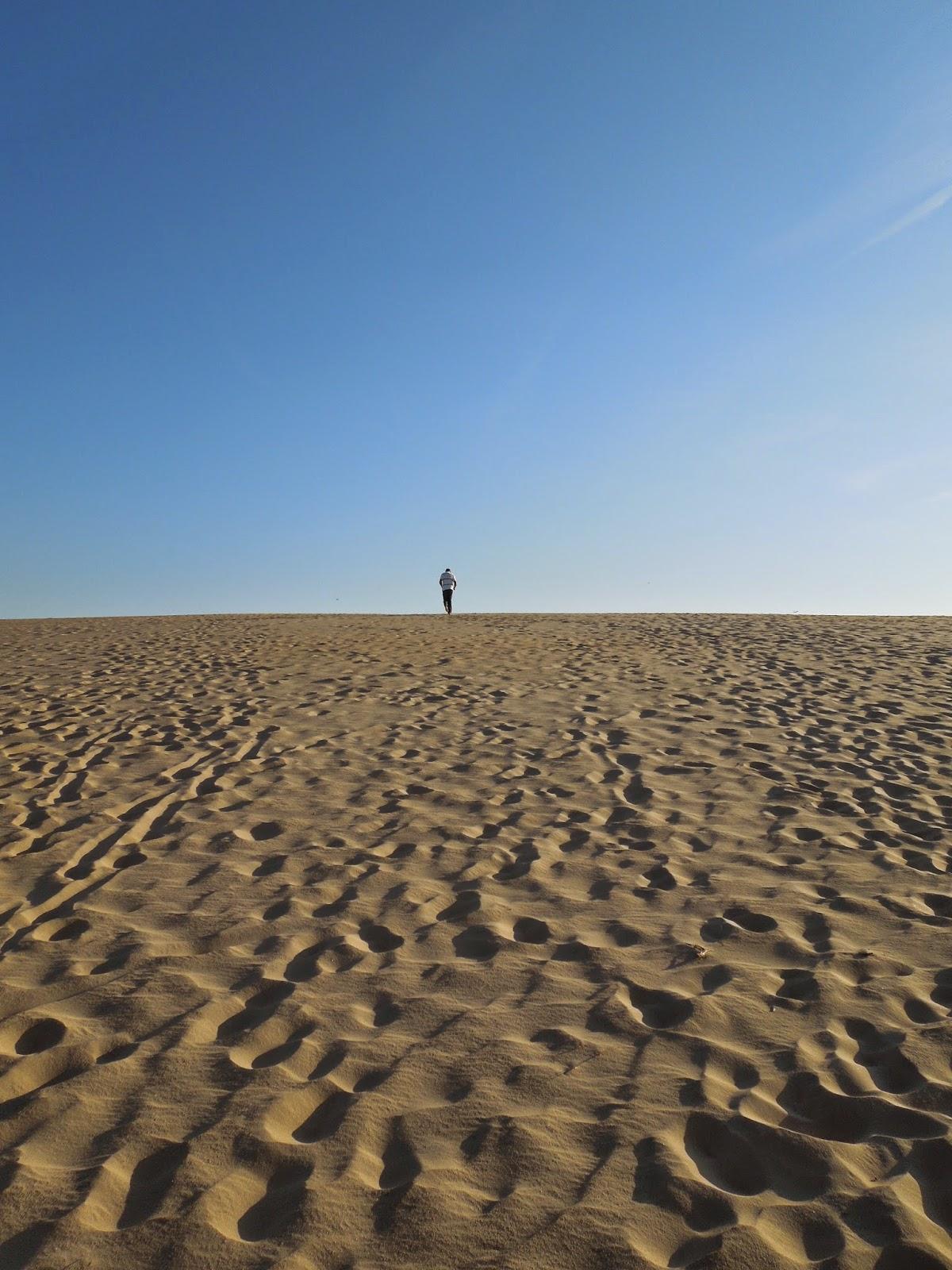 Ron running up dunes