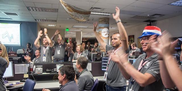 Engineers at Lockheed Martin celebrate after monitoring NASA's Juno spacecraft as it goes into orbit at Jupiter. Photo credit: Lockheed Martin