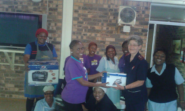 Hollywoodbets Mookgophong handing over goods to the staff at Naboom Old Aged Homes - Corporate Social Investment