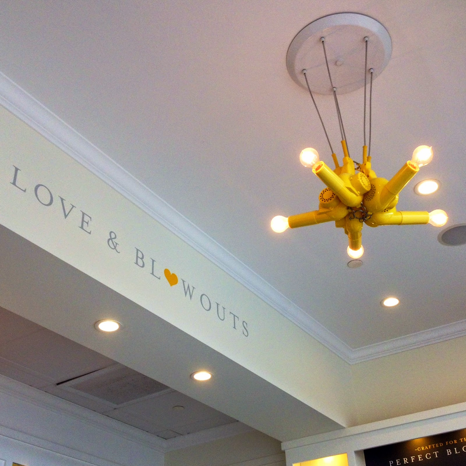 Blow dryer chandelier, drybar Blow dryer chandelier, yellow pops of color, home decor, business decor with yellow