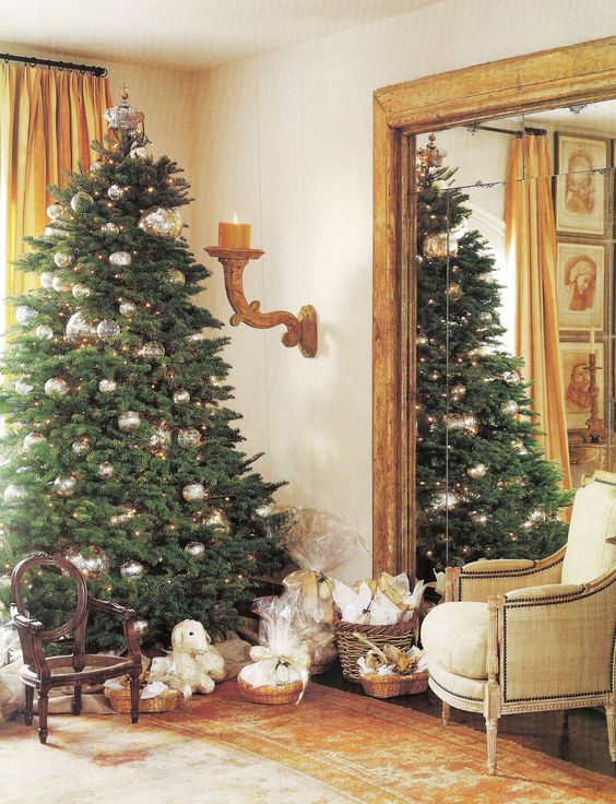 Pamela Pierce designed living room decorated with antiques for a French country Christmas.