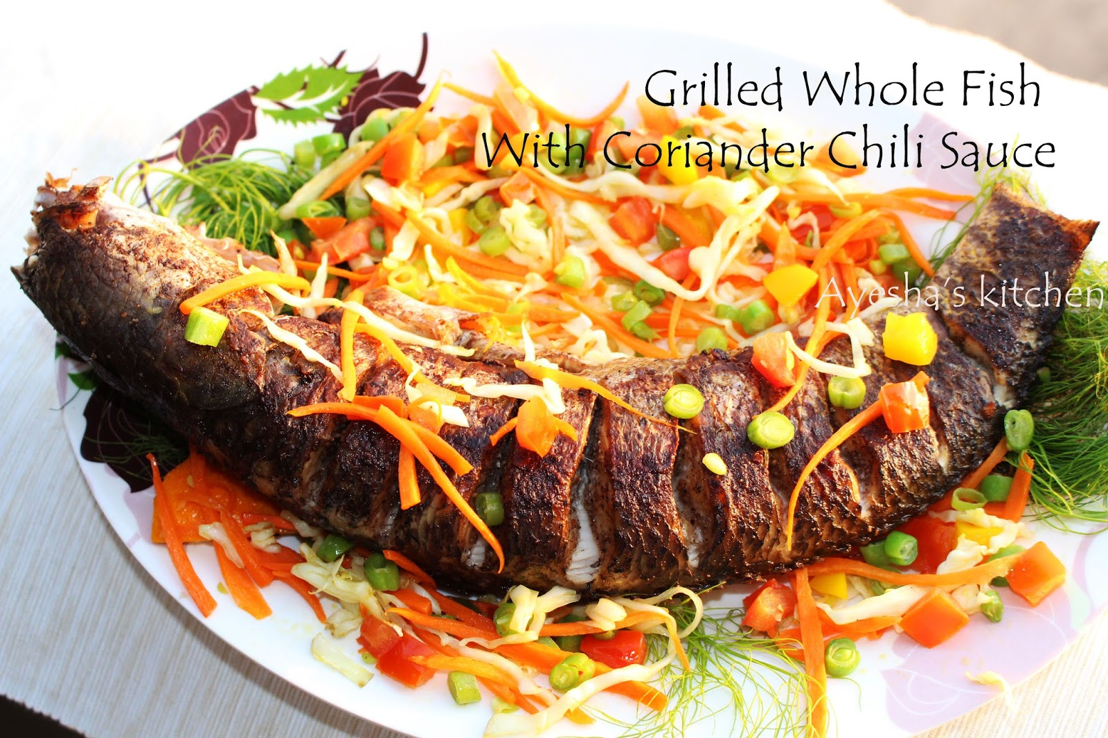 Whole fish grilled in coriander chili sauce grilled fish for Bbq fish grill