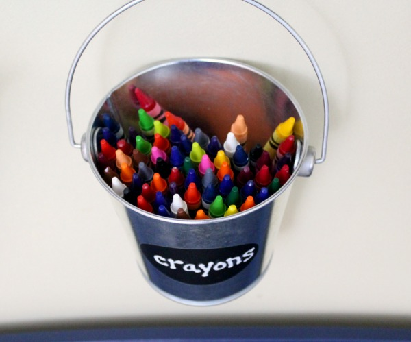 Organized art station for kid's art and craft supplies: Hang metal buckets to easily store supplies such as crayons and markers