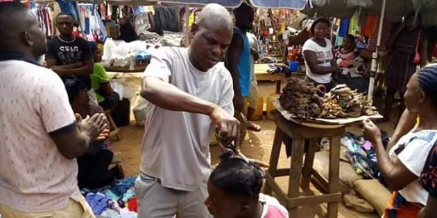 Photos: Outrage as youths storm market in Gboko, Benue and forcefully shaved young men with