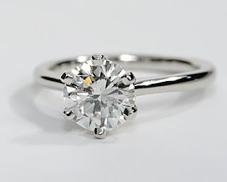 http://www.engagementringwall.com/petite-band-solitaire-engagement-ring