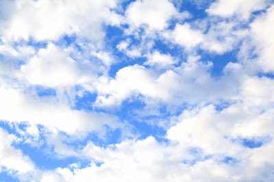 Blue Sky with Fluffy White Clouds - Photo by Mademoiselle Mermaid