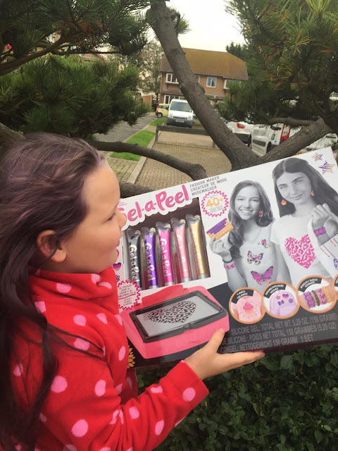 Tilly holding Gel-A-Peel fashion designer box