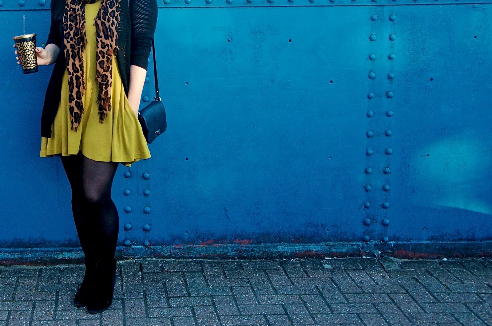 Yellow Dress, Leopard Scarf, Leopard Tumbler Cup, Black Tights, Black Crossbody leather bag and black suede ankle boots