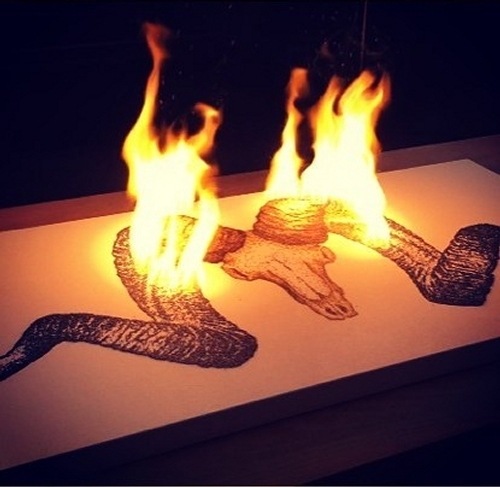 09-Ram-Skull-Danny-Sherving-Paint-with-Gunpowder-and-then-set-it-on-Fire-www-designstack-co
