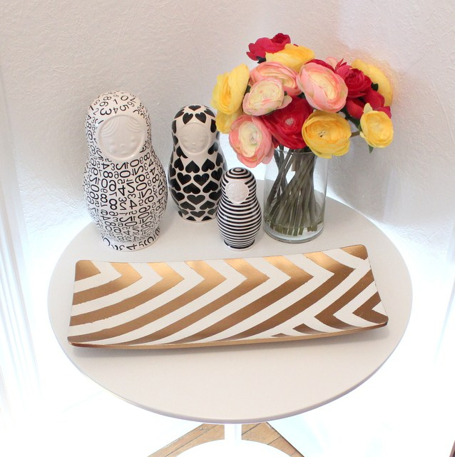 DIY gold stripe tray on a white table