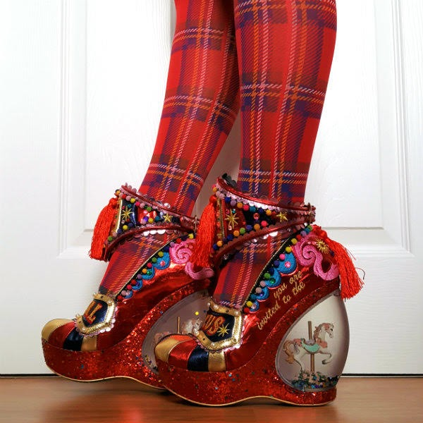 walking wearing red metallic circus themed shoes with carousel horse heel