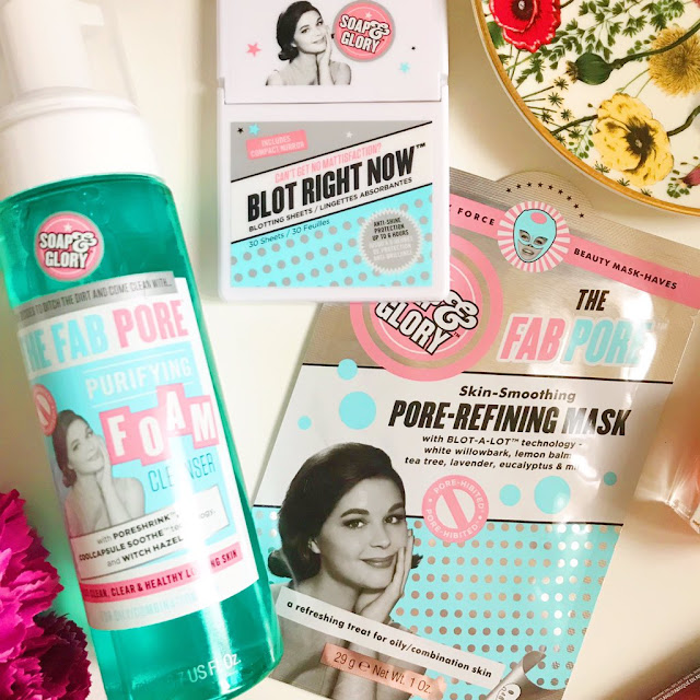 flatlay - Soap and Glory Pore Refine range, foam cleanser, blotting sheets and face mask. Flowers in bottom left corner