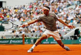 Roger Federer wins Roland Garros opener in style