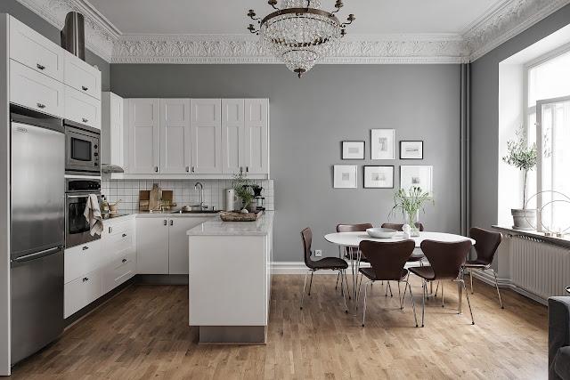 Tonuri de gri, alb și maro în amenajarea scandinavă a unui apartament de 48 m²
